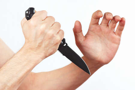 Hand position for the defense with a army knife on a white background