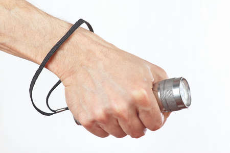 Hand holding a led lantern on a white background photo