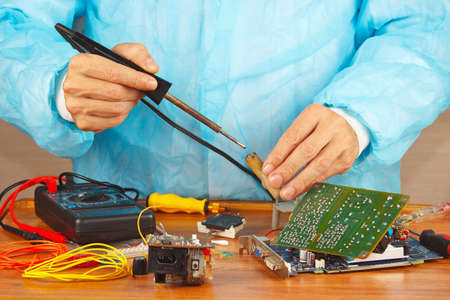 solder: Master solder electronic hardware in the service workshop Stock Photo