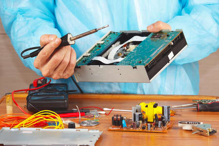hardware repair: Repair electronic hardware with a soldering iron in the service workshop