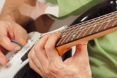 Musician Put Fingers For Chords On Electric Guitar Closeup Stock