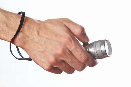 Hand holding a torch on a white background photo