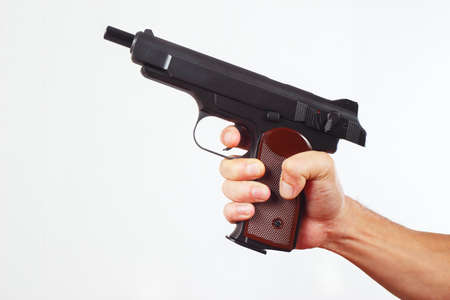finger on trigger: Hand with discharged gun on a white background