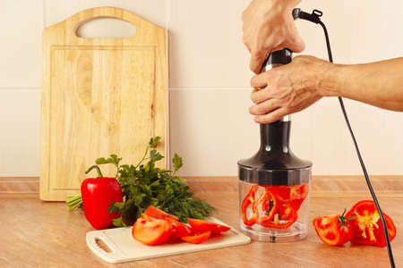 shred: Hands chefs are going to shred red pepper in a blender