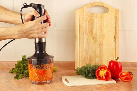 shreded: Hands chefs shreded vegetables in a blender