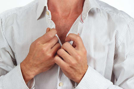 fastened: Hands a man fastened the buttons on the bright shirt close up Stock Photo