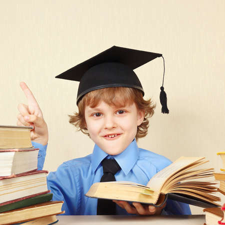 quoted: Little smiling boy in academic hat quoted the old book