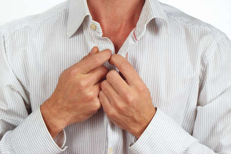 fastened: Hands a man fastened his bright shirt close up