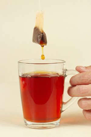 Cup of fresh strong tea in the hand