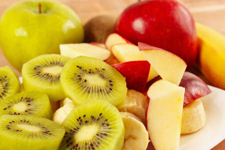 healthy food: Fresh whole and sliced fruit close up