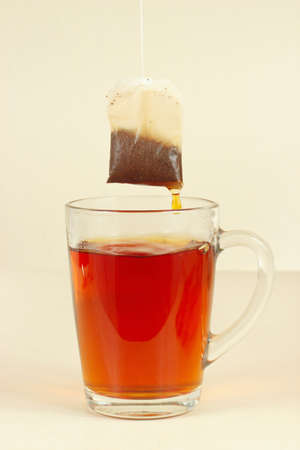 Tea bags over the glass with aromatic hot tea