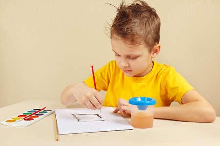 beginner: Beginner artist in a yellow shirt painting colors