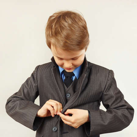 fastened: Little cute boy fastened his business suit Stock Photo