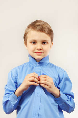 fastened: Little cute boy fastened his bright shirt
