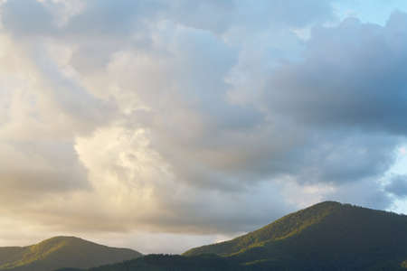 forested: Beautiful cloudy sky above the forested mountains in the summer