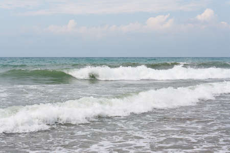 Sea waves against the cloudy sky in the morning before the storm Stock Photo