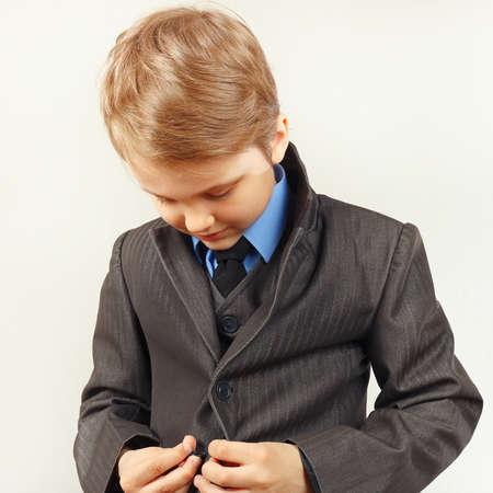 fastened: Little cute gentleman fastened his elegant suit