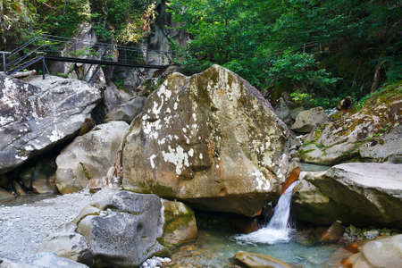 quite: Small charming waterfall in a mountain forest Stock Photo