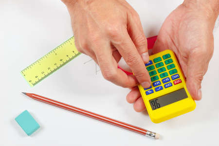 compute: Hands compute using a digital calculator over a workplace of the engineer Stock Photo