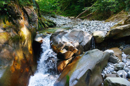 quite: Small lovely waterfall in a mountain forest