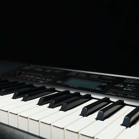 Keys of the digital organ on a black background