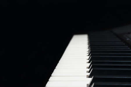 Keyboard of the digital piano on a black background