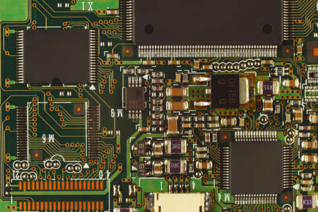 microprocessor: Electronic circuit board with microchips from a modern device close up.