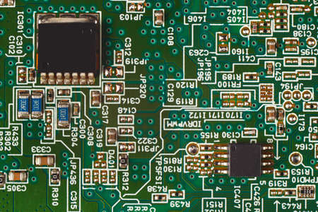 Microelectronic circuit with digital components board close up. Stock Photo