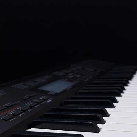 Electronic piano on a black background Stock Photo