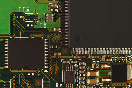 Microelectronic circuit with digital microchips board close up.