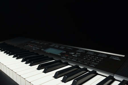 Keyboard of the synthesizer on a black background Stock Photo