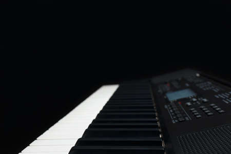 Keyboard of the digital synthesizer on a black background Stock Photo