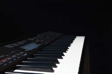 Electronic organ on a black background