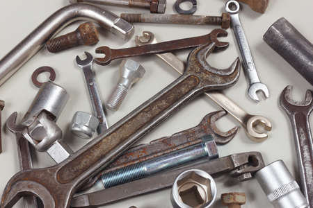 New and old metal tool for repairing machines close up 写真素材