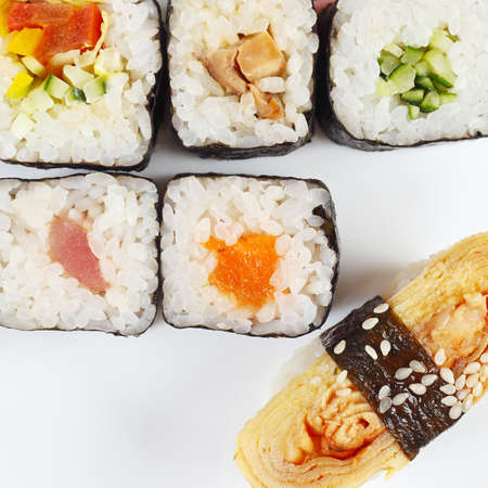 Traditional sushi set on a white background close up. View from above.
