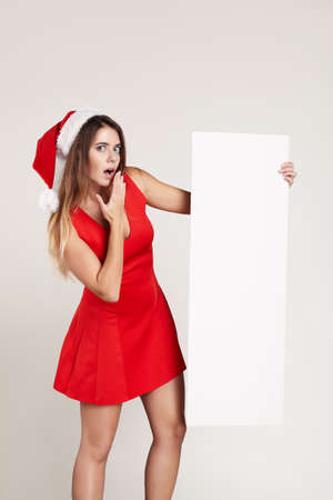 dress form: Vertical portrait of christmas girl with wineglass on white background red dress Stock Photo