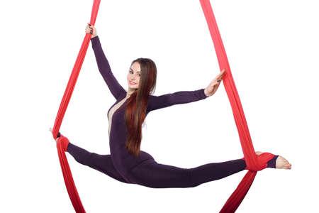 Woman girl practicing aerial air yoga acrobatics in studio isolated white background silk gymnast tissue acrobat