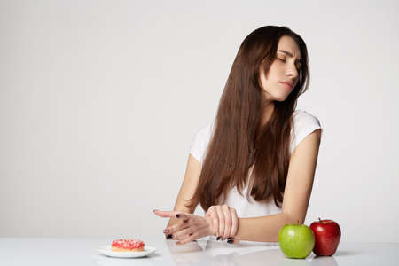 woman beauty girl with fruits and donut apple on gray white background