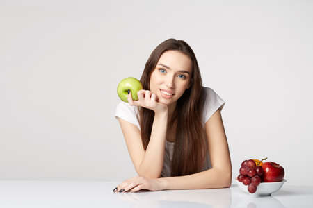 woman beauty girl with fruits and grapes apple on gray white background