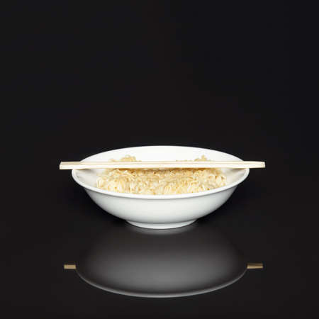 japanese cookery: Noodles in the bowl with chopsticks Stock Photo