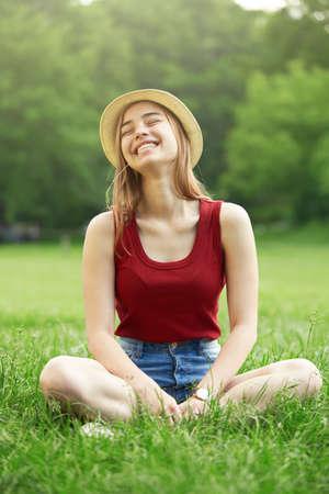 cute happy girl on grass summer Standard-Bild
