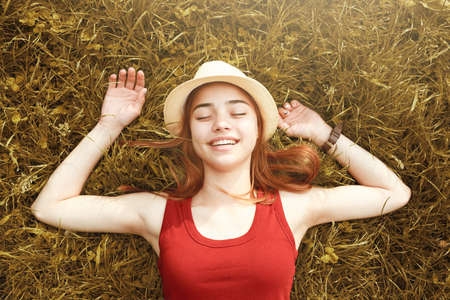 cute happy girl on grass autumn