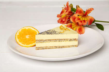 Sweat cake with orange on plate on wooden background