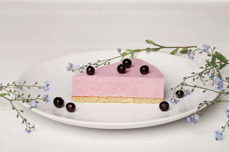 Sweat cake with berries on plate on wooden background