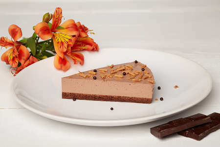 Sweat cake with chocolate on plate on wooden background Standard-Bild