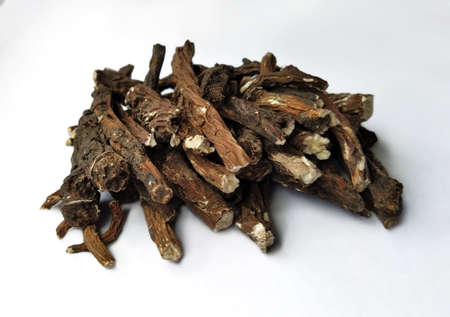 dandelion roots on a white background. herbal medicine. a bunch of sticks, a medicinal plant and a treat for rodents
