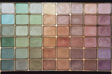 Closeup of colorful eyeshadow makeup palette photo
