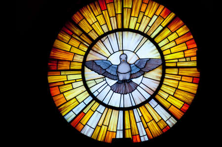 Stained glass picture of Outpouring of the Holy Spirit - photo taken in a church  photo