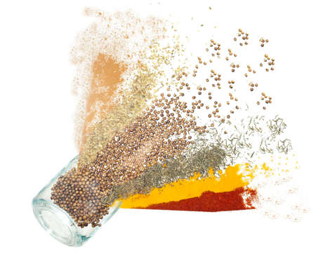 taste, flavor explosion concept. Explosion of spices jar like a cannon shot. Isolated thyme, red pepper, curry, cinnamon, basil, charlock. Stock Photo - 14307900