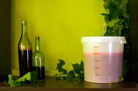 fermenting: home winery stuff  vine, red wine fermentor with fermenting pipe, fermenting tub and bottles Stock Photo